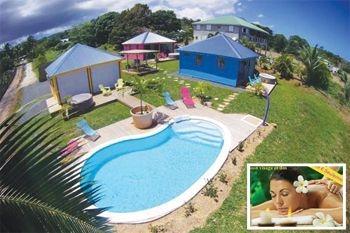 185.80€ un forfait massage « Bien-être et Plénitude » plus un séjour de 2N/4 Pers dans un superbe bungalow (Jacuzzi individuel, piscine, vue mer) avec Deals Guadeloupe